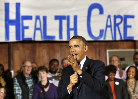 obama health care sign